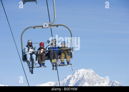 Family on chair lift - Stock Photo