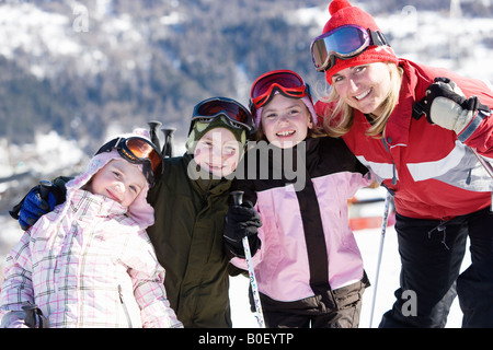 Mother with three children smiling - Stock Photo