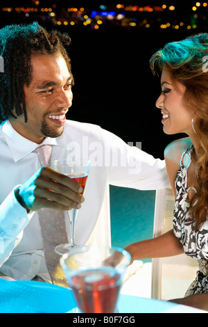 Man and woman drinking champagne - Stock Photo