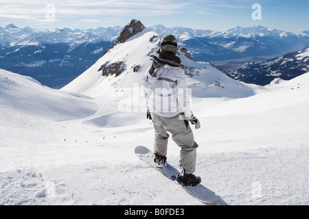 Snowboarder on top of mountain - Stock Photo