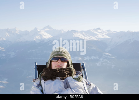 Young woman relaxing in mountains - Stock Photo