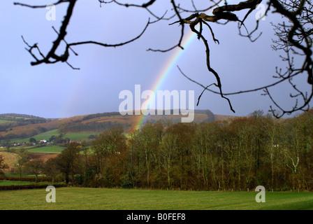 Double rainbow over farmland in Somerset - Stock Photo