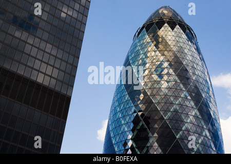 Swiss Re Building and Aviva Building London England United Kingdom - Stock Photo
