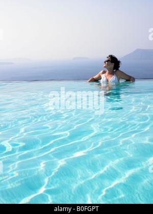 Woman in swimming pool - Stock Photo