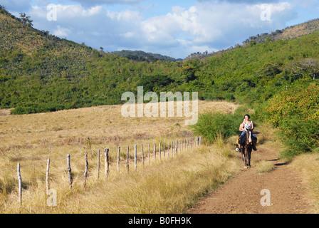 Female tourists on horseback Trinidad Cuba - Stock Photo