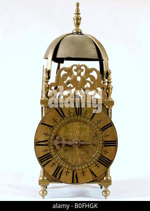 Antique lantern clock - Stock Photo