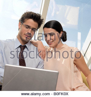 Couple looking at laptop - Stock Photo
