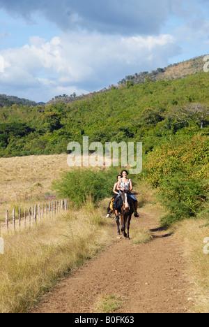 Female tourists on horseback - Stock Photo