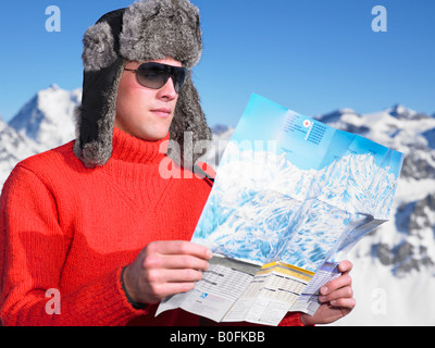 Young man looking at map - Stock Photo