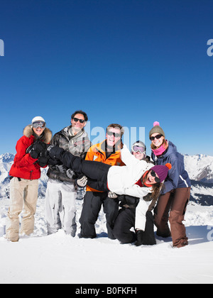 Group carrying young woman - Stock Photo