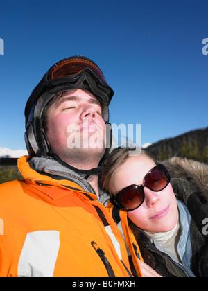 Couple on ski lift - Stock Photo