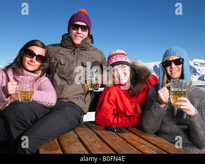 Group of friends having drink on terrace - Stock Photo