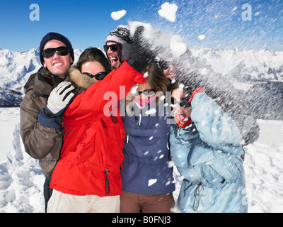Snowball hitting group on mountain top - Stock Photo