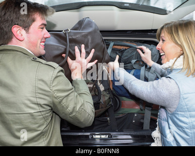 Couple packing car - Stock Photo