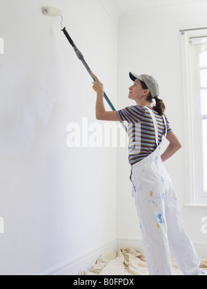 Woman decorating room - Stock Photo