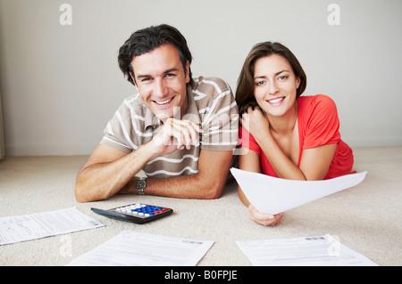 Couple work on home finance - Stock Photo