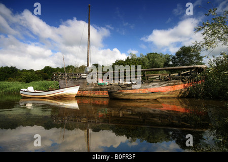 devon river boats reflection in mirror still water - Stock Photo