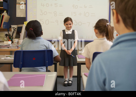 Girl doing her presentation in class - Stock Photo