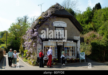 Tourists visiting Thatched shop and tea room at Godshill Isle of Wight England - Stock Photo