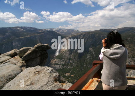a visitor viewing yosemite falls from glacier point - Stock Photo