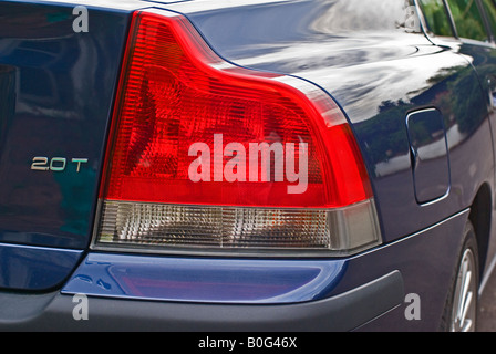 Right rear tail light cluster on a Volvo S60 saloon car - Stock Photo