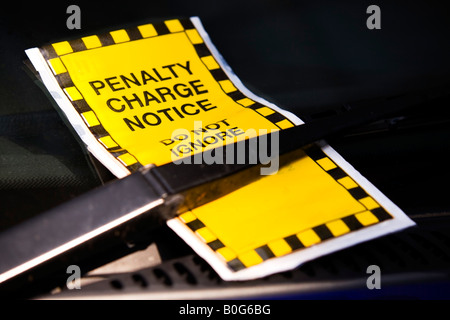 Parking ticket on car screen - Stock Photo