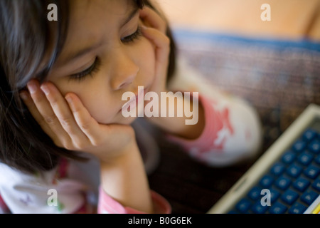 Girl Lying On Floor With Hands Behind Head Smiling Stock