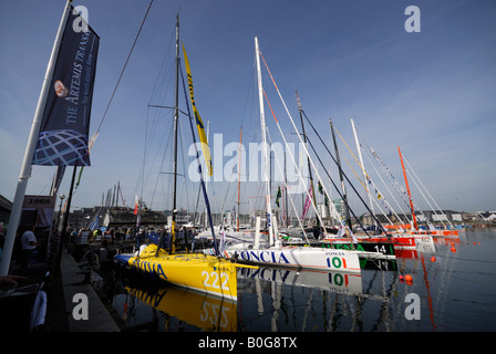 Yachts moored at the start of the Transat 2008 transatlantic yacht race in Plymouth, UK, with Transat flag flying - Stock Photo