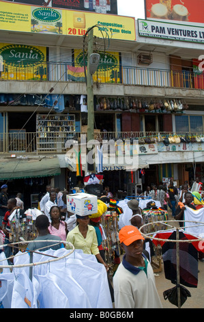 Street vendors offering second-hand clothes in the streets of Accra - Stock Photo