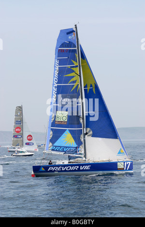 Class 40 racing yacht Prevoir Vie skippered by Benoit Parnaudeau heads for the start line of the 2008 Transat race - Stock Photo