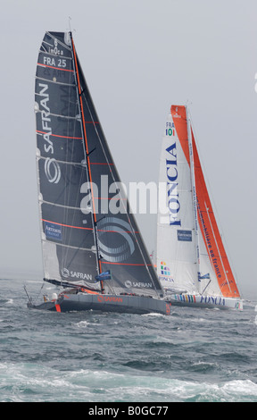 Racing yachts Foncia and Safran at the start of the 2008 Transat transatlantic yacht race in Plymouth - Stock Photo