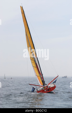 Racing yacht heads for the start line of the 2008 Transat transatlantic race in Plymouth, UK - Stock Photo