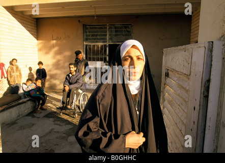Homeless family living in an abandoned mental asylum, Baghdad, Iraq. - Stock Photo