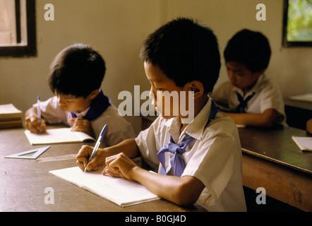 Boys writing in a primary school, Vientiane, Laos. - Stock Photo