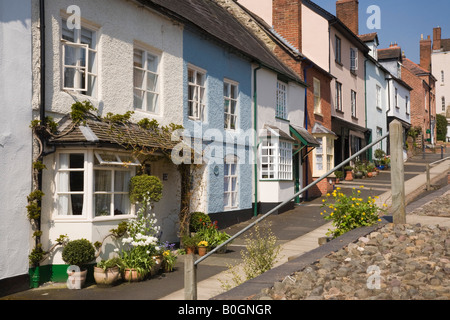 Row of picturesque colourful old terraced cottages town houses on a hilly residential street in Ludlow Shropshire - Stock Photo