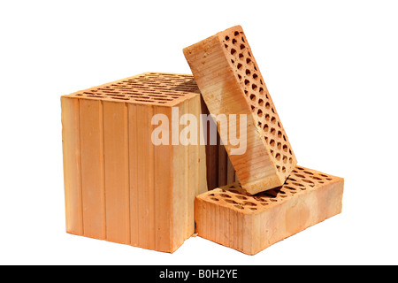 One hollow clay block and two perforated bricks isolated on white background - Stock Photo