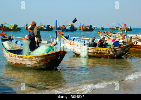 Fishing boats in the fishing port of Mui Ne in Vietnam, Southeast Asia - Stock Photo