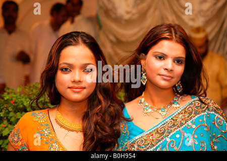 Two young women, guests at a Sufi wedding held at a Sufi shrine in Bareilly, Uttar Pradesh, India, Asia - Stock Photo