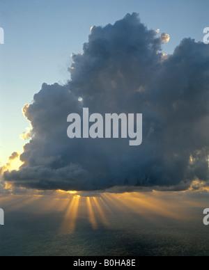 Peak of Stromboli Volcano, sunbeams, rays of sunlight, Aeolian Islands, Sicily, Italy - Stock Photo
