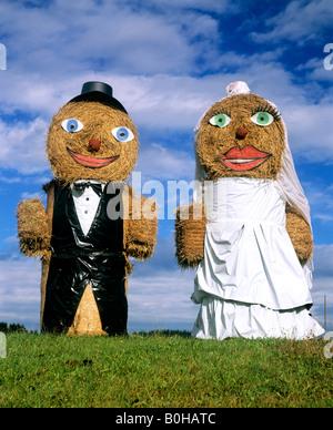 Bridal couple made out of bales of straw, wedding, Upper Bavaria, Bavaria, Germany - Stock Photo