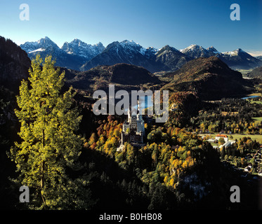 Neuschwanstein Castle, panoramic view in autumn, Alpsee, Allgaeu Alps, Allgaeu, Bavaria, Germany - Stock Photo