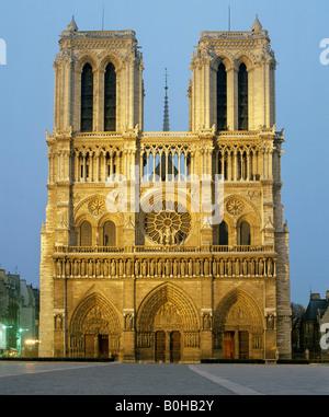 Notre Dame de Paris at dusk, west facade, gothic cathedral, Paris, France - Stock Photo