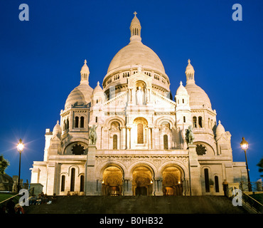 Sacre-Coeur Basilica in Montmartre at dusk, Paris, France - Stock Photo