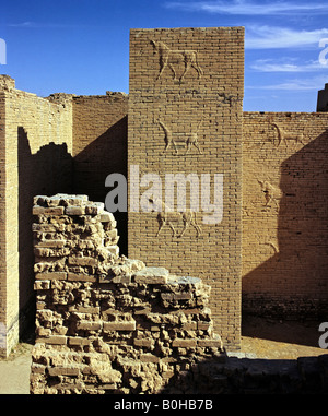 Relief on a brick wall, Babylonian ruins, Iraq, Middle East - Stock Photo