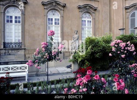 Rose garden, stone statue and white bench in front of the Corps de Logis, baroque residential palace, Ludwigsburg, - Stock Photo