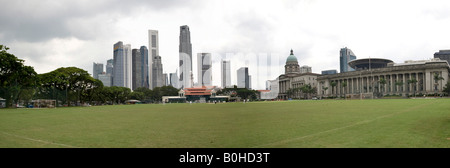 City Hall and Supreme Court with financial district skyline and the Singapore Cricket Club, founded 1852, in foreground, - Stock Photo