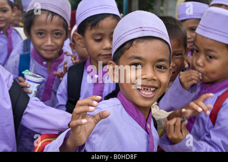 Muslim schoolchildren in front of their school, Matram, Lombok Island, Lesser Sunda Islands, Indonesia - Stock Photo