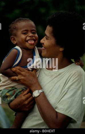 A portrait of a Fijian mother with her son, Abaca, Fiji.