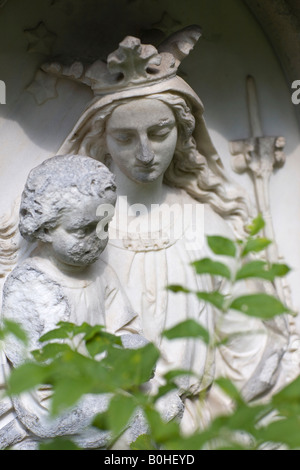 Stone Madonna with child, Alter Suedfriedhof, old cemetery in Munich, Bavaria, Germany - Stock Photo