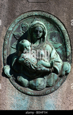Grave relief, Madonna and child, Alter Suedfriedhof, old cemetery in Munich, Bavaria, Germany - Stock Photo